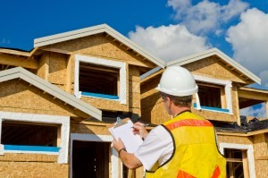 An image of an inspector performing a new home building inspection