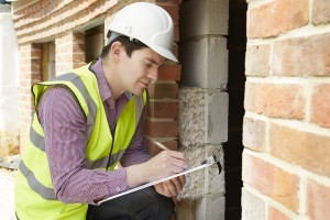 An image of an inspector performing a pre purchase or pre sale building inspection